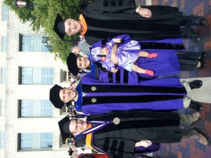 Photo By Andrew Radosevich : Lusik Cherkezyan and Andrew Radosevich pictured after their PhD hooding by Prof. Allen Taflove. Accompanied by Charlie Radosevich and Prof. Allen Sahakian.