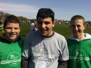 Photo By Mitchell Kasselman and Jake Pozin : Kenny, Mitchell, and Jake after the 100 meter race at the Special Olympics in 2011.http://www.triblocal.com/highland-park-highwood/community/stories/2011/05/team-keshet-wins-4-100m-relay-at-the-special-olympics-on-may-1-2011/index.html